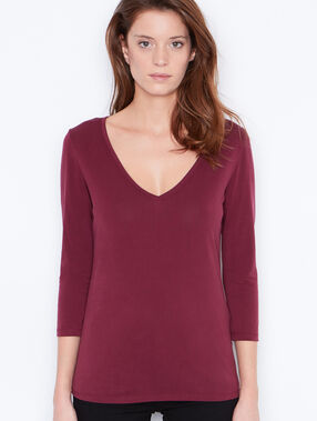 3/4 sleeve top with v-neck plum.