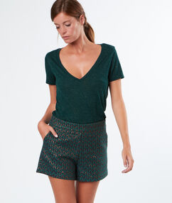 Jacquard shorts with golden details green.