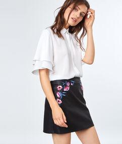 Mini skirt flowers embroidered black.