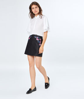 Mini skirt flowers embroidered black.