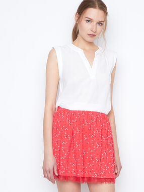 Flowing skirt coral.