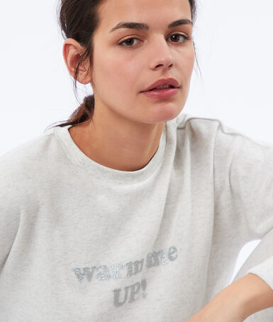 Warm and soft heathered sweatshirt with message ecru.