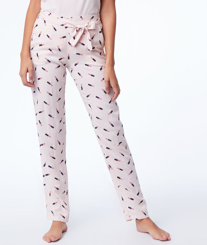 Lipstick print pyjama trousers pink.