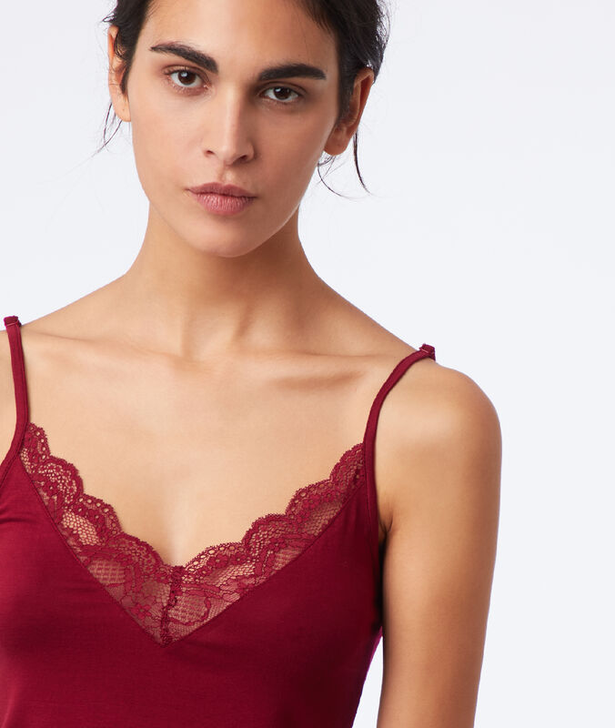 Lace-yoked top garnet burgundy.