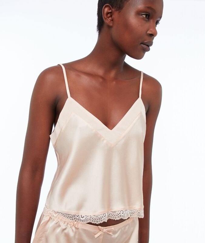 Satin top, buttoned in the back powder pink.