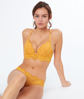Tanga de encaje floral amarillo.