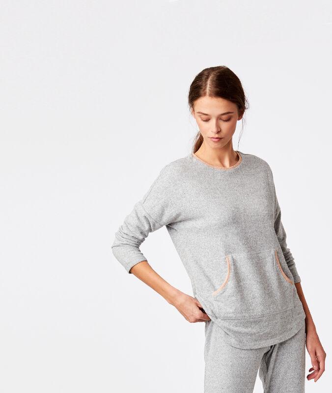Top avec poche centrale gris.