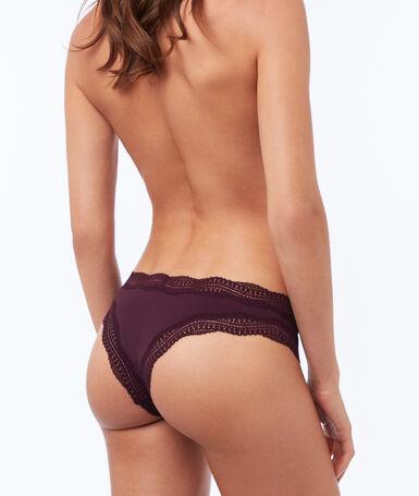 Ornate lace-edged tanga violet.
