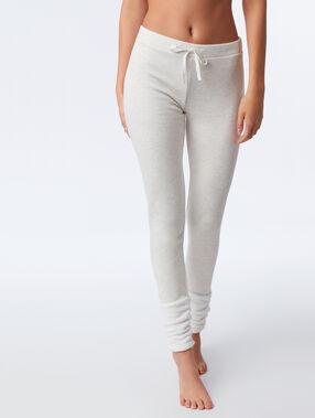 Pants with faux fur details beige.
