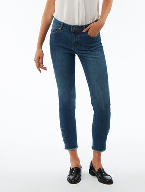 Slim leg jeans with button ankle detail stone.