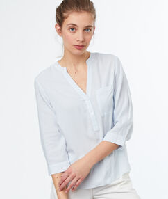 Blouse light blue.
