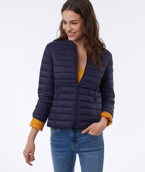 Down jacket with the inside lined with polka dots