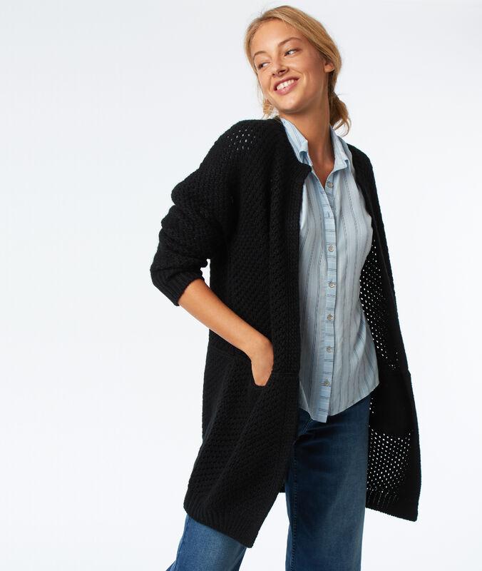 Gilet tricoté noir.