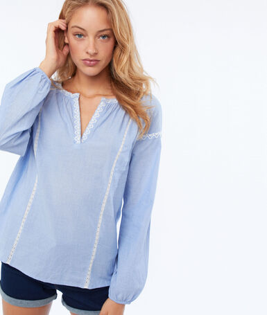 Blouse with embroidered details sky blue.
