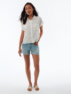 Torn jean shorts bleached light blue.