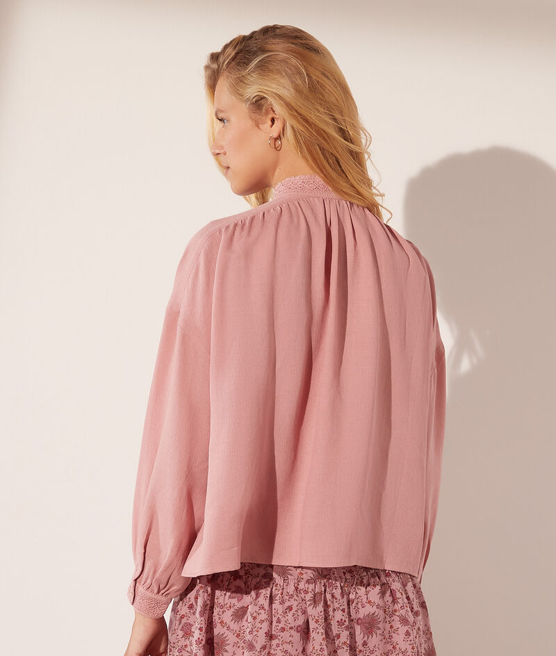 Blouse with buttoned high collar