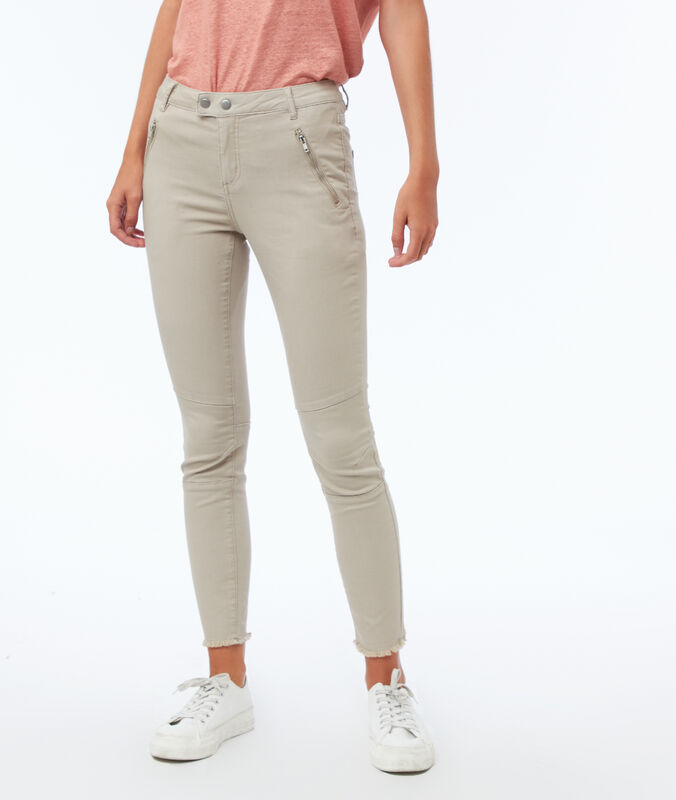 Slim-fit trousers with zipped pockets dune.