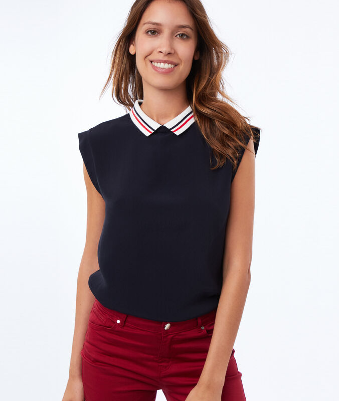 Top with peter pan collar tied in the back navy blue.