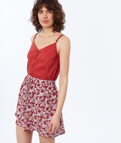 Fluid skirt with leaves tomato red.