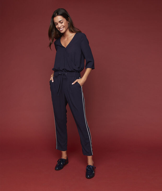 Playsuit with side stripes navy blue.