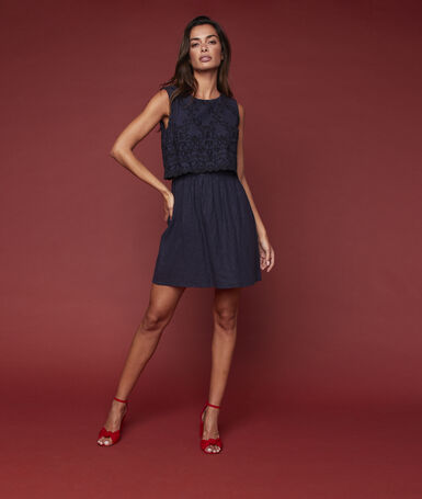 Bare back dress with embroidery detail navy blue.