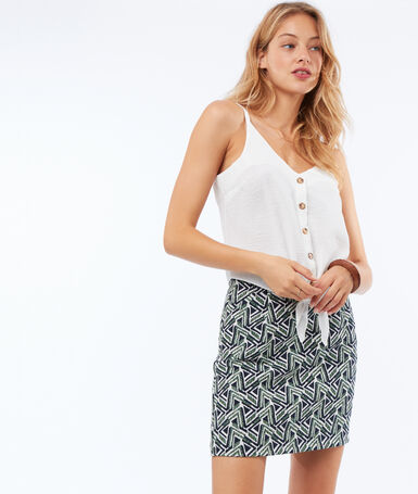Short skirt with geometric print green.