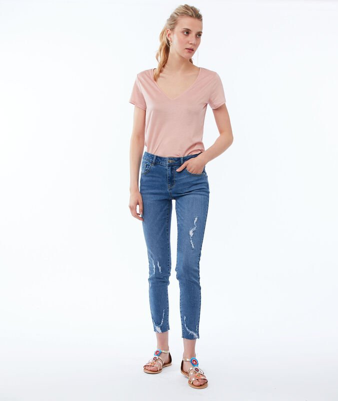 Skinny jeans with torn effect stone.